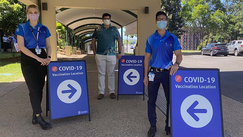 JCU medical students and Dr Lachlan Gordon standing in front of JCU vaccination centre.